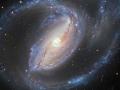 Dvojica galaxii, masívna požierajucu mrňavú...Galaxia 1097a (tá obrovská) patrí do rodiny Seyfertových galaxii...v jadre má ale riadnu nenásytnú čiernu dieru...dvojica je vzdialená 50 miliónov svetelných rokov v súhvezdi Fornax (Pec) (Eduard Boldižár)