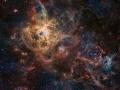 Najväčšia emisná hmlovina Tarantula v Miestnej kope galaxii nachádzajúc vo Veľkom Magellanovom mraku. od nás vzdialená 180 000 svetelných rokov...Veľký Magellanov mrak sa nachádza v súhvezdí Mečiara (nie, nemá názov súhvezdia nič spoločné s bývalým slovenským politikom)...ak by bola hmlovina vzdialená len 1500 svetelných rokov, bola by viditeľná v jednej polovici našej oblohy...(Eduard Boldižár)